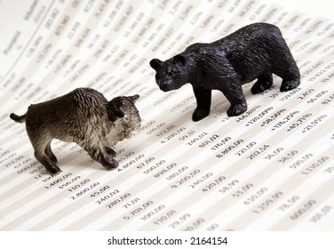 Stock market report with bull and bear figure.