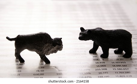 Stock market report with bull and bear.