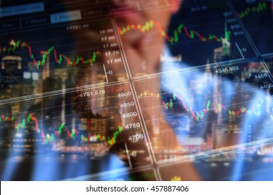 Stock market trading floor. Trader, broker look at the screen on stock market graphs of abstract index. Financial, business, stock exchange background.