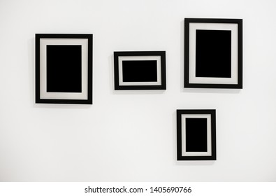 Stock for mockup. Black frames with mat for photos or paintings. Frames hang on the wall.