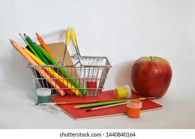 Stock up on creativity and learning. Find all your classroom essentials here learn more. School supplies concept. Shopping basket with pencils and paints close up isolated white. Back to school.