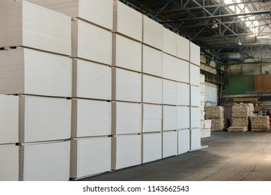 Stock of particle boards. Chipboards in the warehouse are ready for use. Woodworking industry