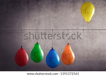 A balloon that sticks out of a group