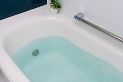 A bathtub containing hot water
