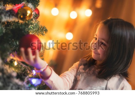 A beautiful little girl posing for a new year and christmas concept.  Soft focus #768805993