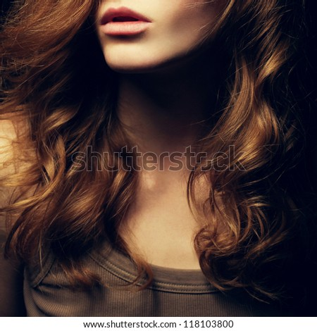 A Beautiful red-haired girl's portrait. Natural hairstyle. Healthy Hair. Close up. Studio shot