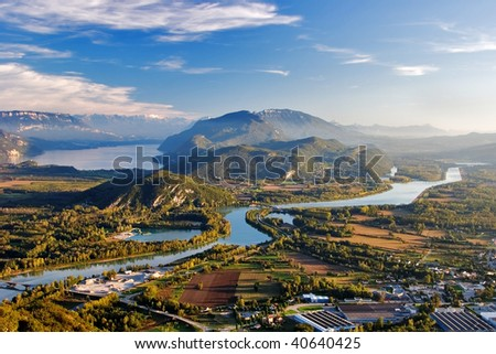 A beautiful rural landscape to France, low mountains, lake and the river