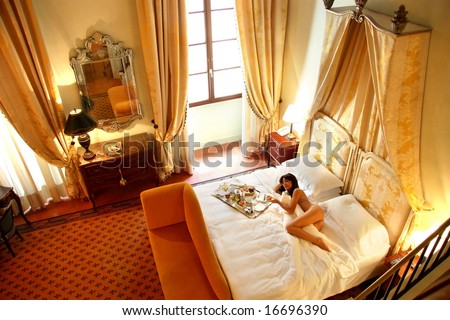 a beautiful woman in a room of a luxury hotel