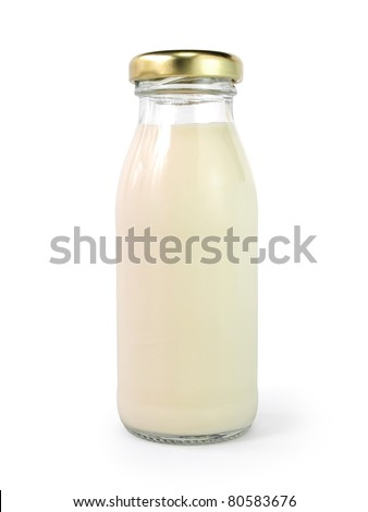?A bottle of milk with golden cap isolated on white background