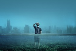 A boy observes a city in a world submerged by water. Global warming, melting of arctic ices or Great Flood concept.