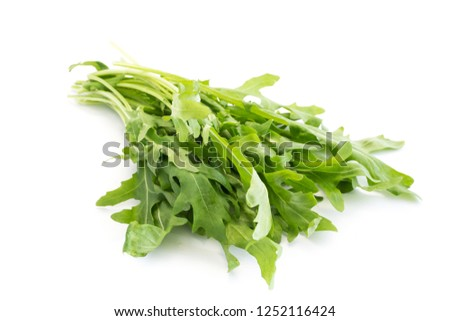 A bunch of rocket arugula isolated on white background Foto stock ©