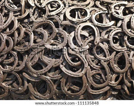 a bunch of welded horseshoes for luck