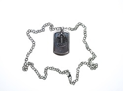 a chain of white metal with pendant in the form of a scorpion