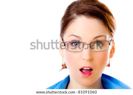 A close up of a pretty woman pulling a shocked face on a white background.