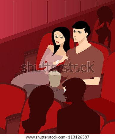 ,A couple at the theater watching a movie