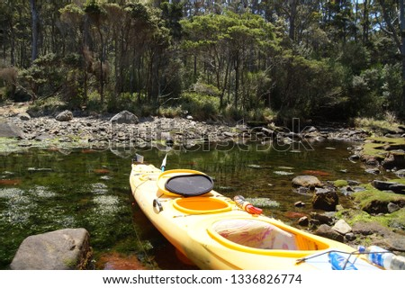 A double canoe in the waters of Tasmanian peninsula