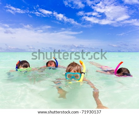 A family snorkeling in the ocean.
