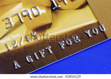 â??A Gift For Youâ?� from a golden gift card isolated on blue