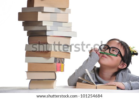 A girl looking at a pile of books with the hope to dive into the land of knowledge.
