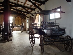 A group of carriages in a room of a museum, Rocha, Uruguay, South America.