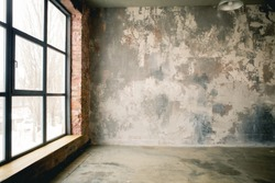 A huge window to the floor on the entire concrete wall with a wooden window sill. Loft industrial grunge interior. Brick and dark background. Place for text