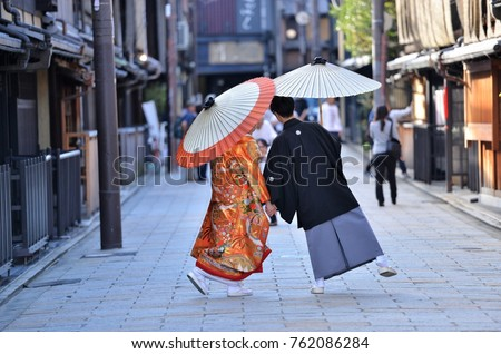 A japanese couple on their wedding day dressed up in traditional kimono taking photo shots in kyoto #762086284