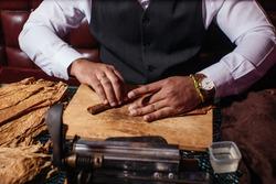 a man makes a homemade cigar