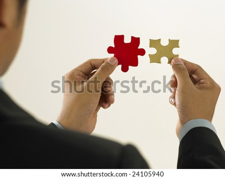 a man try to solve mismatching puzzle