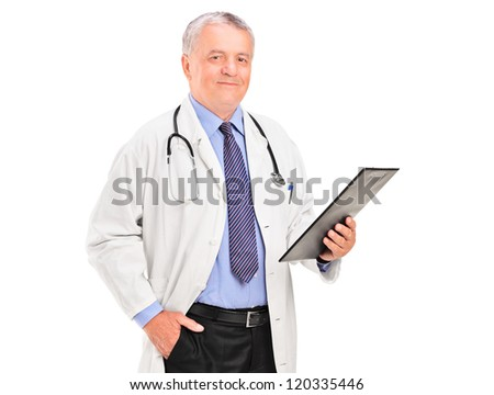 A mature doctor holding a clipboard and posing isolated on white background