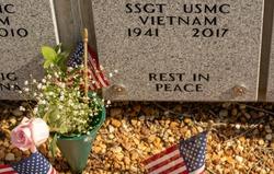 A mausoleum in a military cemetery  memorializes a USMC veteran of the Viet Nam war  (R.I.P. Sir)