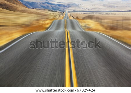 A Mirage on high speed. Magnificent American road and fencings on roadsides from snow drifts