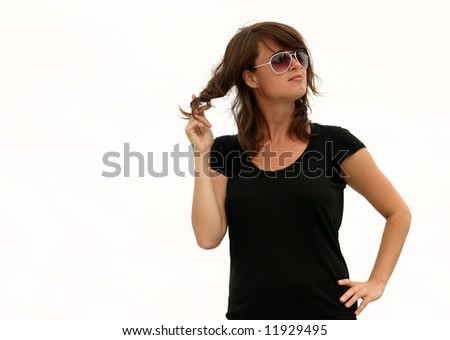- a model posing against a light grey sky (almost white) and twisting her hair