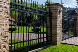 A modern metal fence around the house