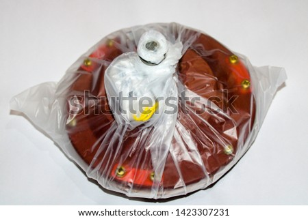 A new  ceiling fan motor ready to assembling isolated on white background. All work is being performed by a licensed master electrician according to National Electric Code standards