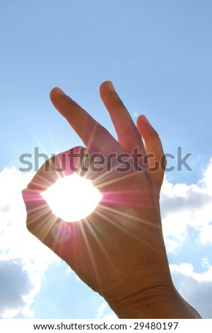 'A OK' sign with sun rays shining through