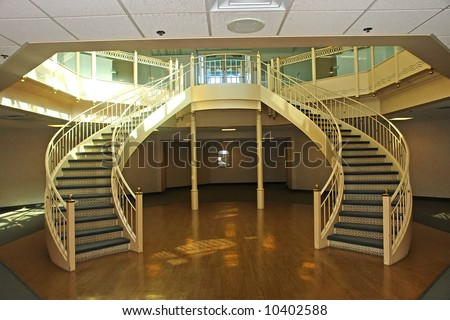 A picture of a beautiful staircase with wonderful curves