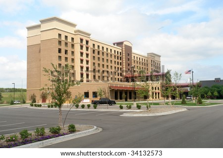 A picture of a newly completed Hotel with empty lot