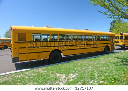 A picture of a yellow school bus parked along street