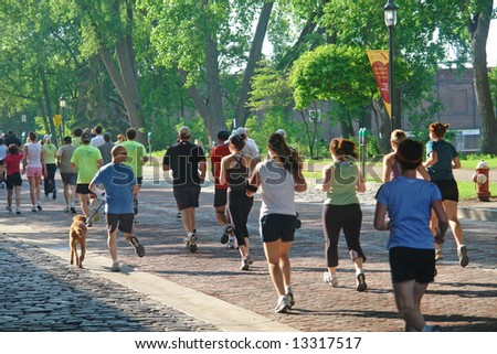 A picture of runners on beautiful summer day in park