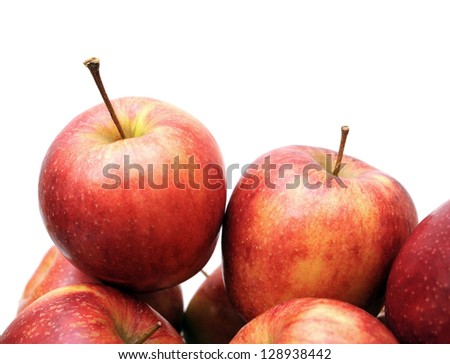 a pile of Jonagold apples against white background