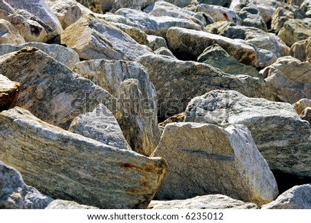 a pile of massive rocks fill the image, suitable for a background