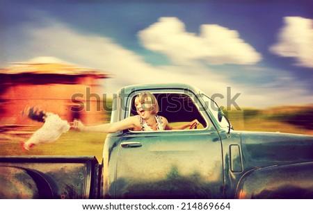 a pretty woman driving a truck ...