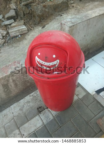 a red bin that is uniquely shaped