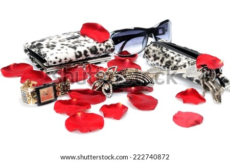 A Red rose petals, women\'s accessory Handbag for keys, sunglasses, wallet, watch. in still life