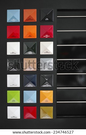 A row of colored metal plates showing the color options of cars