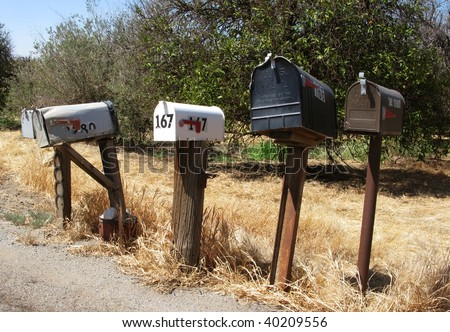 A row of mail boxes in a rural community. USA.