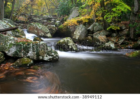 A secluded cascade in the forests of Virginia during Fall of the year. Taken with a slow shutter speed to smooth and soften the water.