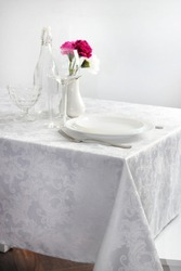 a table with a white tablecloth reservation for one person