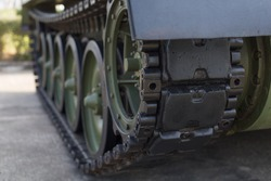 A tank of the second world war.Close up view of world war tank road wheels left side