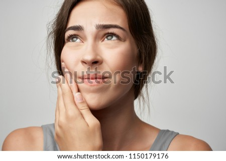 A woman has a toothache.